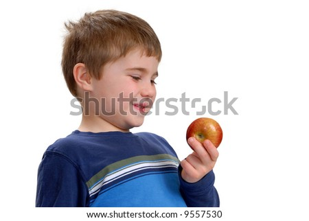 Child ready to eat an apple, isolated on white - stock photo