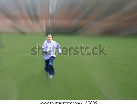 Child running in a park - stock photo