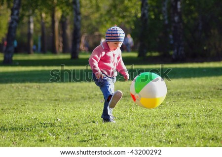 Child runs and game of ball - stock photo