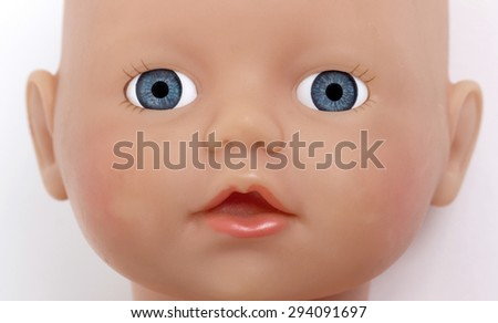 Child's baby doll face, isolated on white - stock photo