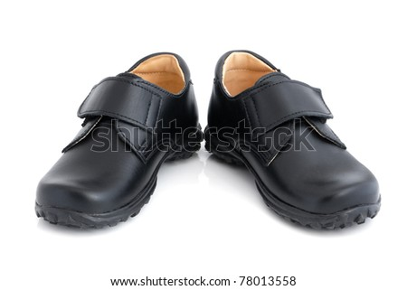 Child's black shoes on a white background - stock photo