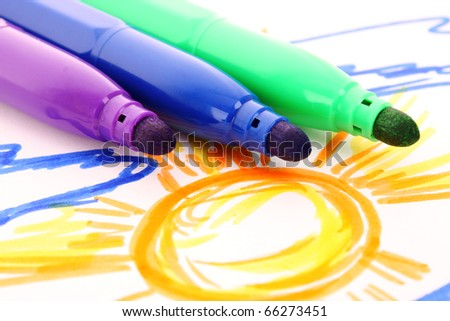 Child's drawing and pens on the table - stock photo