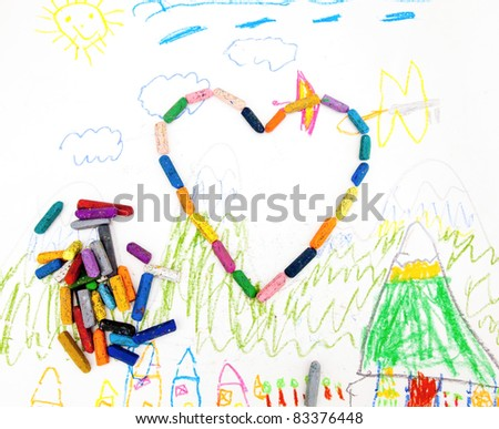 Child's drawing with colored pencils and symbol heart - stock photo