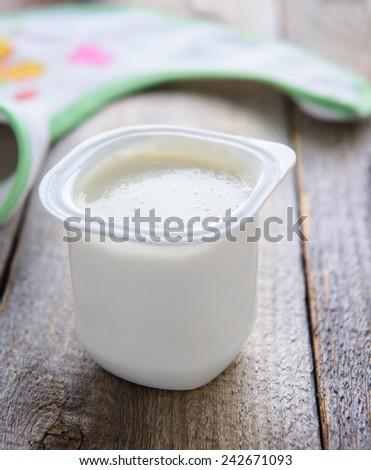 Child`s food: fresh yoghurt - stock photo