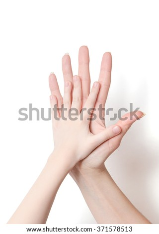 child's hand and adult's hand on white background - stock photo