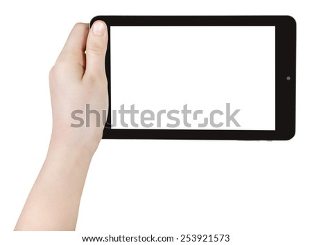 child's hand holding tablet pc with cut out screen isolated on white background - stock photo