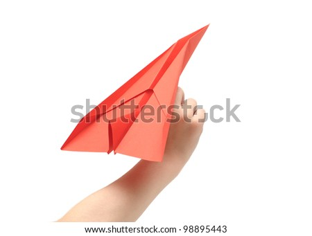 Child's hand launching paper airplane - stock photo