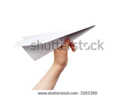 Child's hand launching white paper airplane - stock photo