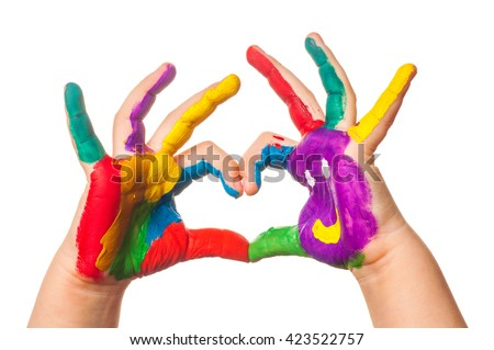 Child's hand painted watercolor in heart shape against white background - stock photo