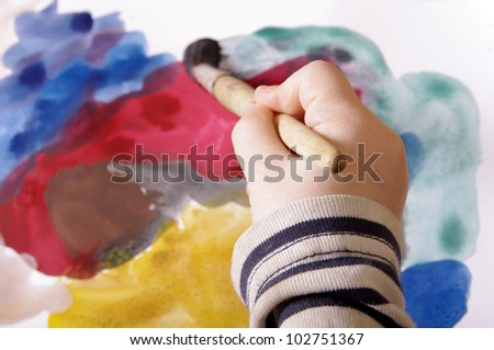 child's hand painting onthe papper - stock photo