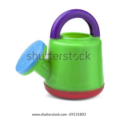 Child's plastic watering can isolated on white - stock photo