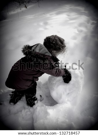 Child's play ... meeting a challenge.  A three year old's hard day at work - stock photo
