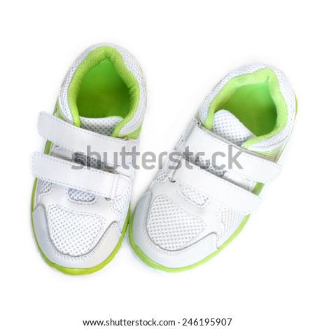 Child's sport shoes on a white background - stock photo