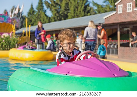 child sail in inflatable boats - stock photo