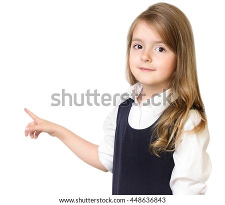 Child school girl pointing with finger isolated on white. Education school study concept. - stock photo