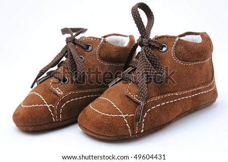 child shoe isolated over a white background - stock photo