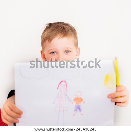 Child showing his own picture with mother and son standing together; boy drawing picture for mothers day; child drawing;  - stock photo