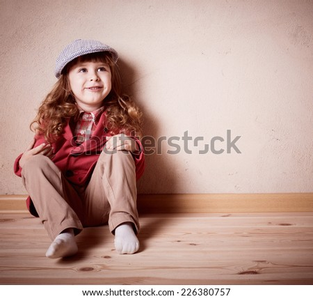 child sitting on the floor in room - stock photo