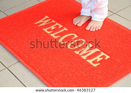 Child Standing On A Floor Mat - stock photo