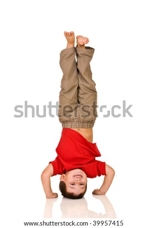 child standing on his arms, yoga - stock photo