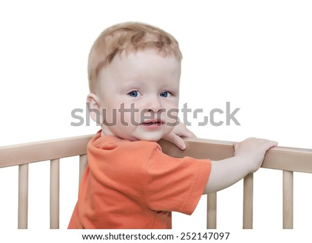 child stay in a bed on the white, isolated - stock photo