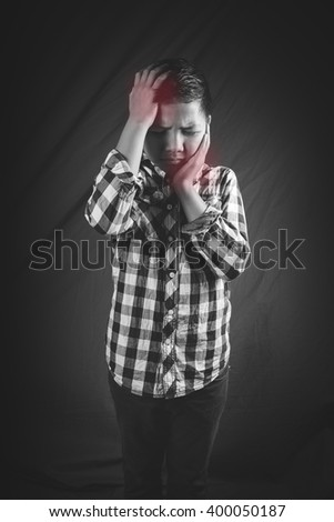 Child suffering in pain - stock photo