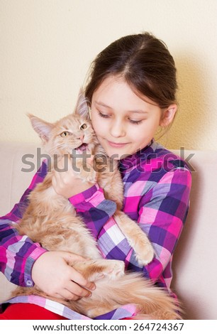 child tenderly embraces kitten - stock photo
