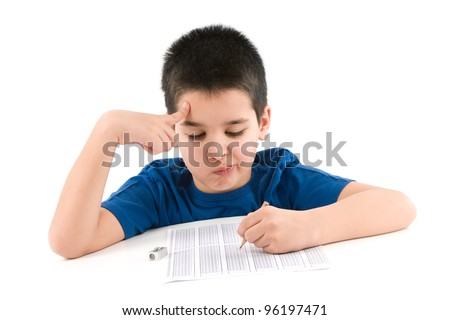 Child thinking to answer test score sheet. - stock photo