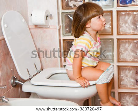 child to the toilet - stock photo