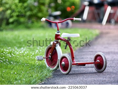 child tricycle - stock photo