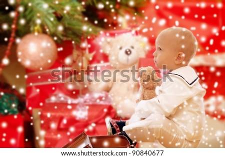 Child under x-mas tree - stock photo