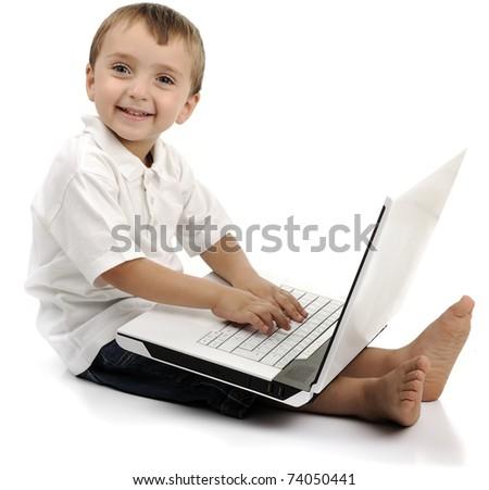 Child using a laptop - stock photo