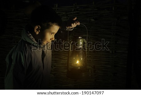 Child walk in the darkness with gas lantern - stock photo