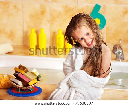 Child washing in bubble bath . - stock photo