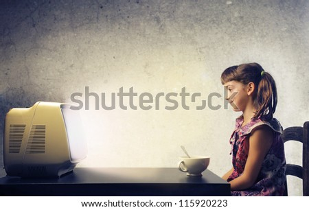 Child watching the TV - stock photo
