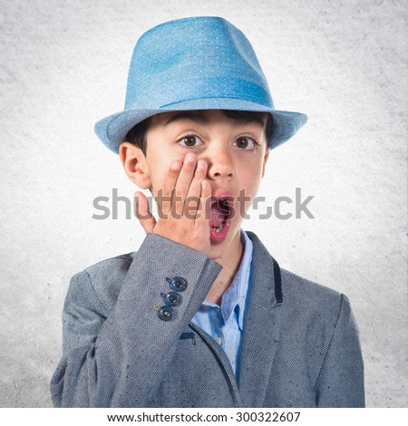 Child wearing a hat doing surprise gesture  - stock photo