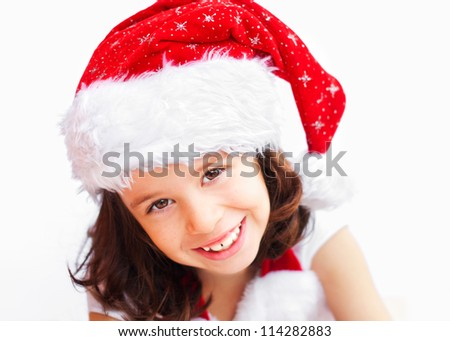 Child wearing Santa Claus christmas hat - stock photo