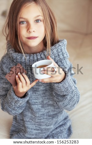 http://thumb101.shutterstock.com/display_pic_with_logo/154447/156253283/stock-photo-child-wearing-sweater-and-drinking-tea-at-home-156253283.jpg
