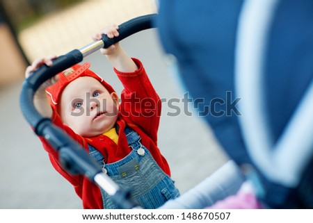 child with a baby carriage - stock photo