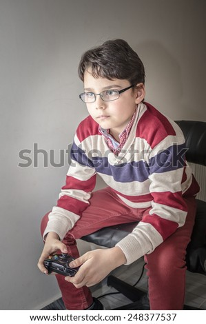Child with a game controller  - stock photo