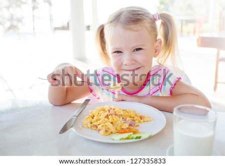 child with a glass of milk - stock photo