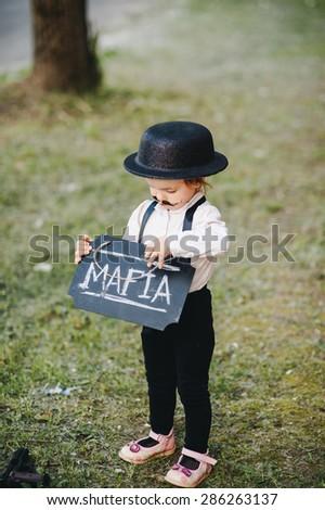 Child with a sign Mafia. Retro Style - stock photo