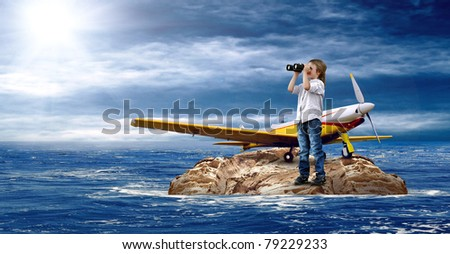 Child with airplane on the island in sea. - stock photo