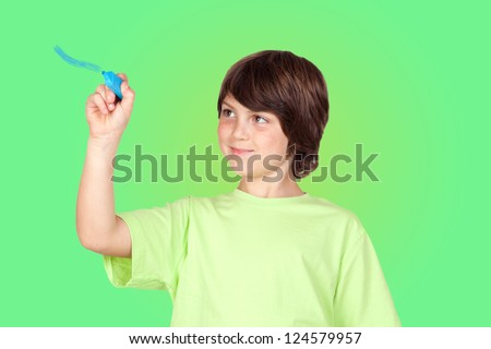 Child with blue pen painting on a green background - stock photo