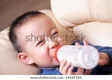 child with bottle of milk - stock photo