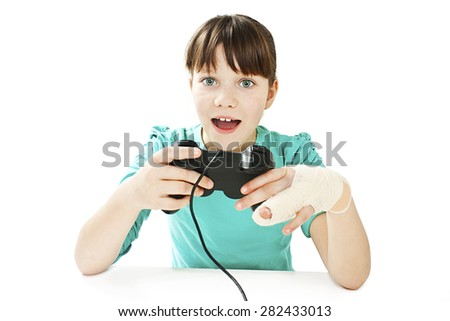 Child with broken arm using video game controller. Isolated on white background  - stock photo