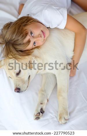 Child with dog - stock photo