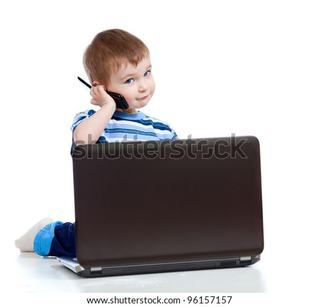 Child with laptop and mobile phone - stock photo