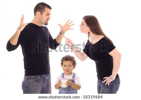 child with milk caught in the middle - stock photo