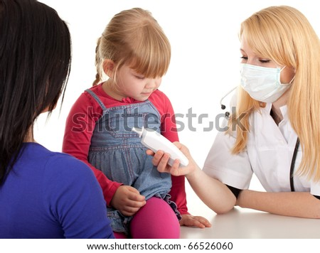 child with mother at doctor - female doctor keeping  thermometer; examining little girl - stock photo